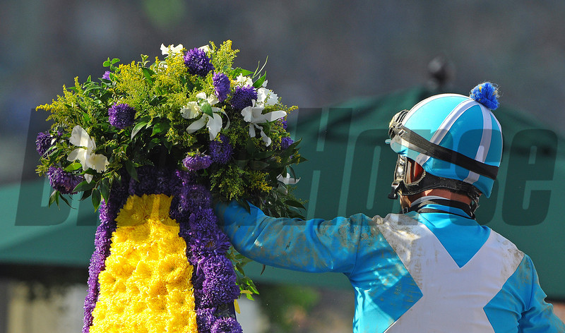 Jockey Aaron Gryder celebrates his first Breeders Cup win, after winning the Marathon with Calidoscopio...<br /> © 2012 Rick Samuels/The Blood-Horse