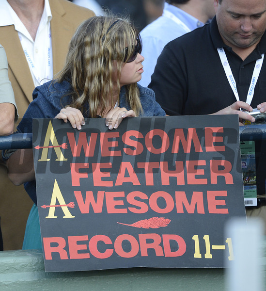 A person holds a sign showing her favorite to win the Ladies Classic at Santa Anita Park in Arcadia, California November 2, 2012.  Photo by Skip Dickstein
