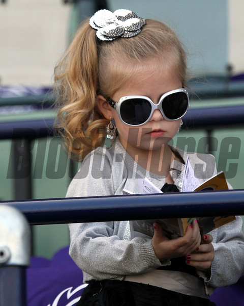 A stylish young racing fan handicapping the Breeders' Cup on November 2, 2012 at Santa Anita Park.