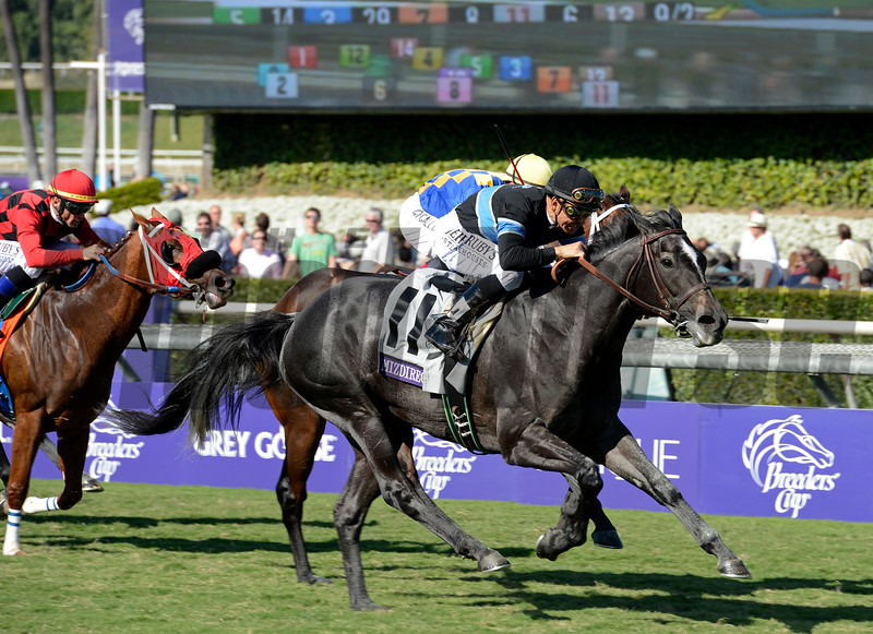 Caption: Mizdirection with Mike Smith wins the Turf Sprint.<br /> Breeders' Cup races at Santa Anita near Arcadia, California, on Nov. 3, 2012.<br /> BCRACES2012         TurfSprint   image943<br /> Photo by Anne M. Eberhardt
