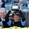 Mike Smith celebrates with the trophy after winning the Breeders' Cup Turf Sprint at Santa Anita Park on November 3, 2012.<br /> Photo by Chad Harmon