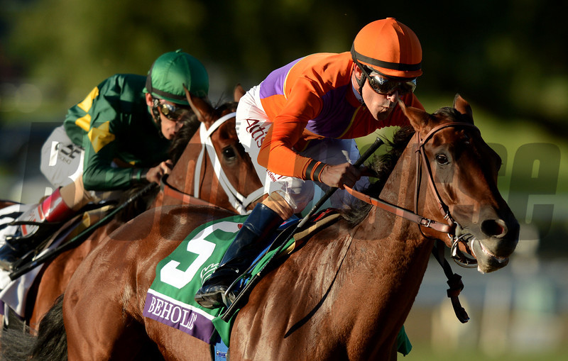 Jockey Gary Stevens and Beholder pull away from John Valazquez and Authenticity as they turn into the stretch to win the Breeders Cup  Distaff at Santa Anita. Photo by Wally Skalij