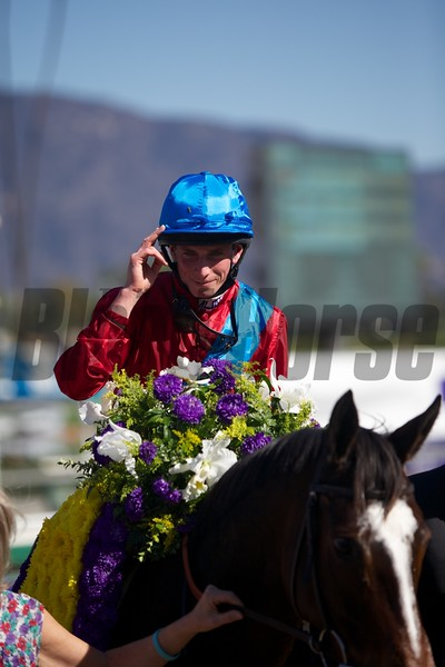 Ryan Moore celebrated winning the Filly & Mare Turf (G. I) atop Dank. Photo by Crawford Ifland.