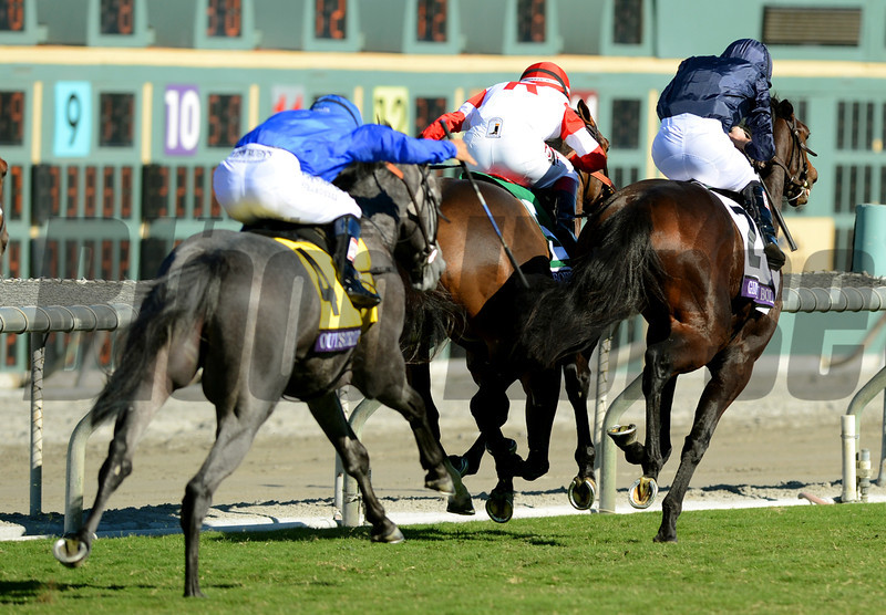 Outstrip and jockey Mike Smith, left, comes from far back to win the Breeders Cup Juvenile Turf at Santa Anita. Photo by Wally Skalij