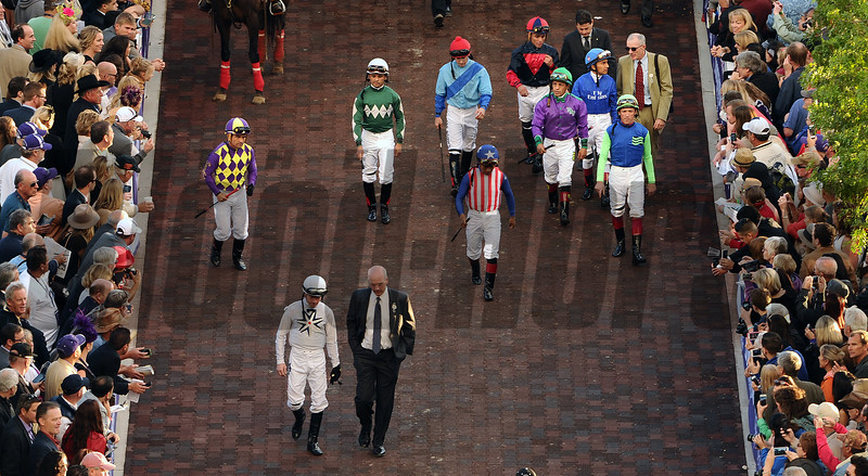 Jockeys walk to the paddock before the Breeders Cup Classic at Santa Anita Saturday. Photo by Wally Skalij