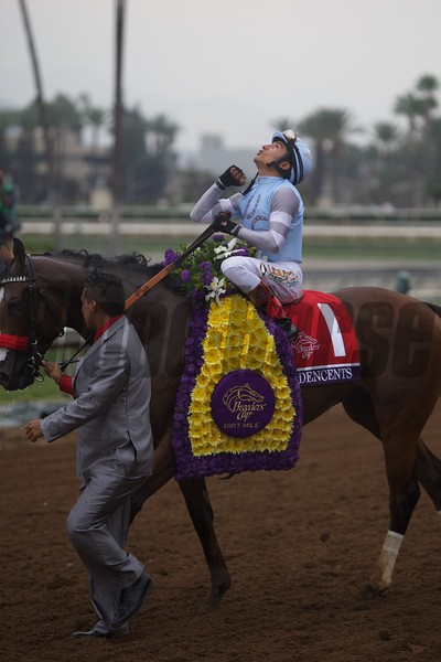 Rafael Bejarano celebrates winning the Breeders' Cup Dirt Mile (G. I) atop Goldencents.