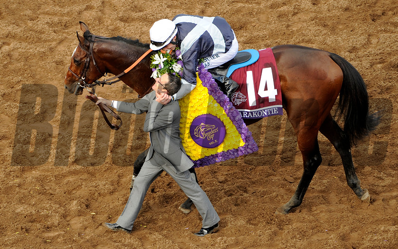Karakonite with jockey Stephane Pasquier celebrates his win in the Breeders Cup Mile at Santa Anita Saturday. Photo by Wally Skalij
