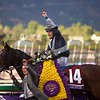 Stephane Pasquier celebrated winning the Breeders' Cup Mile atop Karakontie on November 1, 2014.