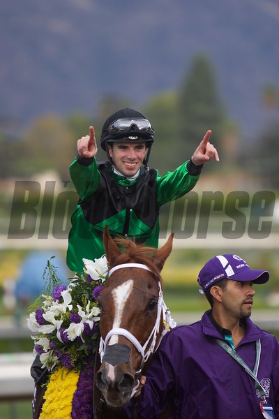 Florent Geroux celebrated winning the Breeders' Cup Sprint (G. I) atop Work All Week.