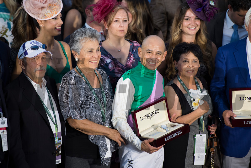 Connections of Arrogate celebrate in the winner's circle after edging out California Chrome to win the Classic (gr. I) at Santa Anita on Nov. 5, 2016, in Arcadia, California.