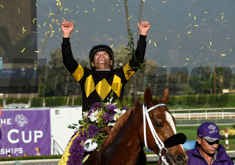 Mike Smith celebrates winning the Filly Mare Sprint (gr. I) atop Finest City at Santa Anita on Nov. 5, 2016, in Arcadia, California.