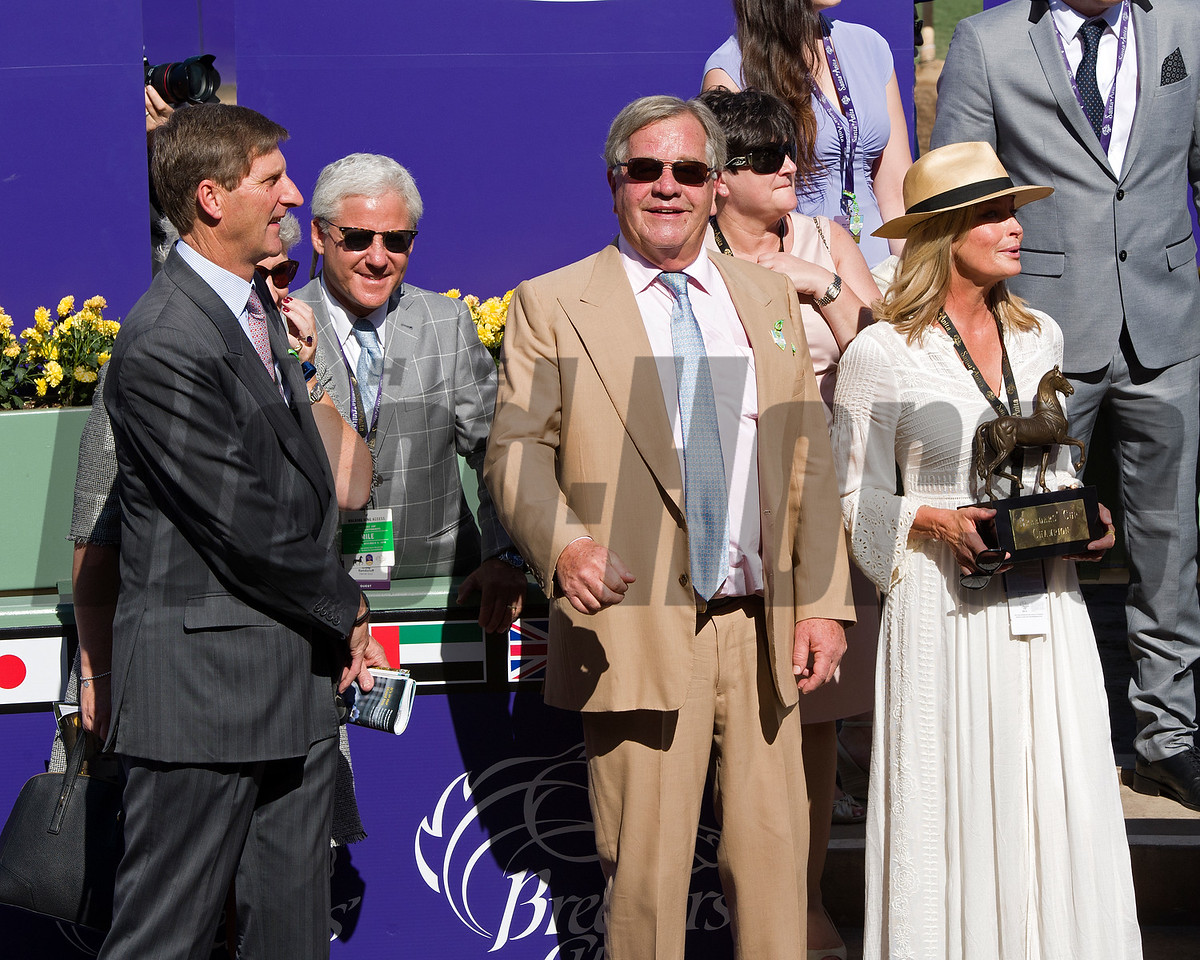 Queen's Trust, with Lefranco Dettori up wins the Filly Mare Turf (gr. I) at Santa Anita on Nov. 5, 2016, in Arcadia, California. l-r, Cheveley Park rep Chris Richardson, Craig Banderoff, Michael Stoute and Bo Derek