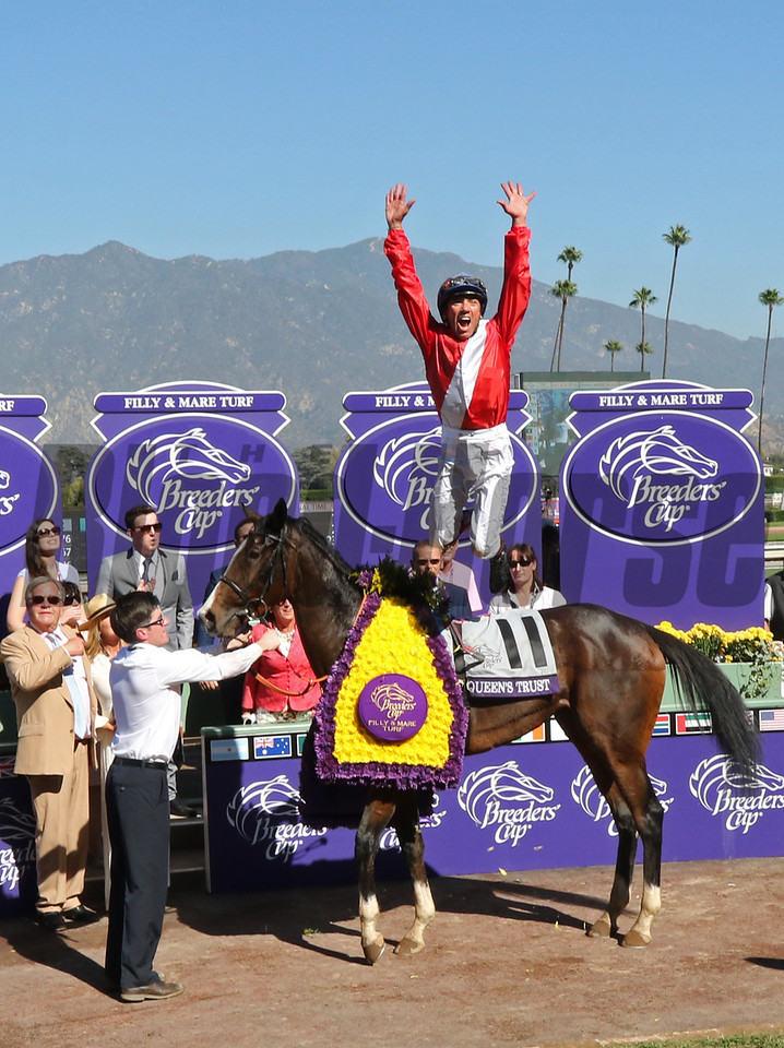 Lefranco Dettori celebrates winning the Filly Mare Turf (gr. I) at Santa Anita on Nov. 5, 2016, in Arcadia, California.