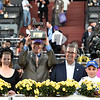 Connections of Tourist celebrate in the winner's circle after winning the Mile (gr. I) at Santa Anita on Nov. 5, 2016, in Arcadia, California.