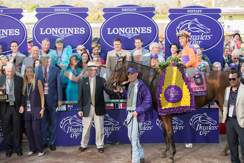 Connections of Beholder in the winner's circle after winning the Longines Distaff (gr. I) at Santa Anita on Nov. 4, 2016, in Arcadia, California.