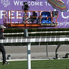 Jockey Frankie Detorrie runs past a sign going up at Santa Anita Nov. 3, 2016 in preparation the Breeders' Cup in Arcadia, California.  Photo by Skip Dickstein
