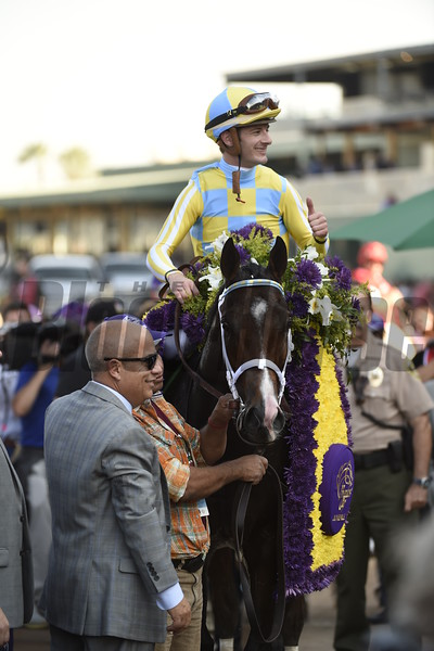 Julien Leparoux celebrates after winning the Sentient Jet Juvenile (gr. I) at Santa Anita on Nov. 5, 2016, in Arcadia, California.