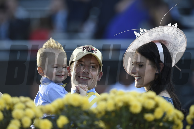 Julien Leparoux and family celebrate after winning the Sentient Jet Juvenile (gr. I) at Santa Anita on Nov. 5, 2016, in Arcadia, California.