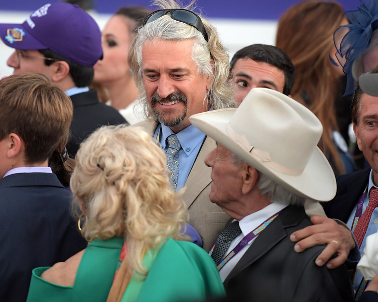 Steve Asmussen with his mom and dad in winner's circle. BC Classic Gun Runner