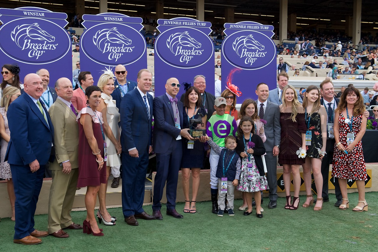 Connections of Rushing Fall celebrate wining the Breeders Cup Juvenile Fillies Turf at Del Mar on November 3, 2017. Photo by Anne Eberhardt.