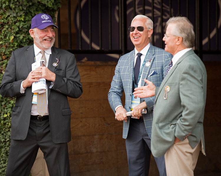l-r, Jack Wolf, Todd Pletcher, and Bill Mott<br /> Rushing Fall wins the Juvenile Fillies Turf at Del Mar on November 3, 2017. Photo by Anne Eberhardt.