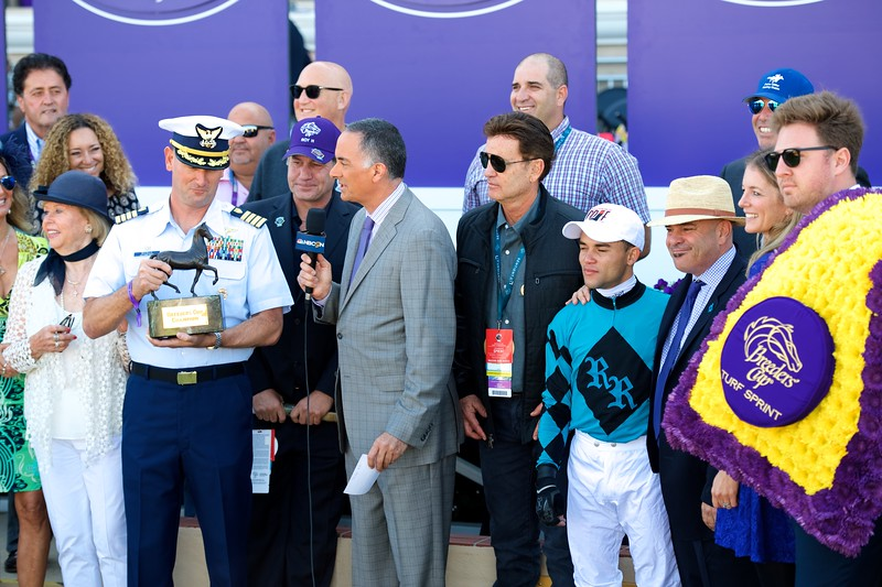 Connections of Stormy Liberal after winning the Breeders Cup Turf Sprint on November 4, 2017. Photo by Anne Eberhardt