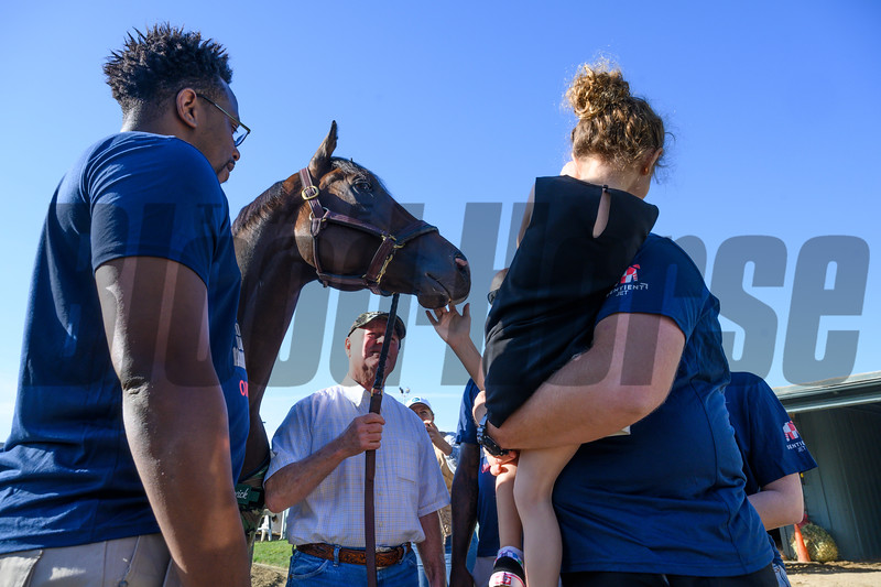 Trainer Dick Mandella, center shows off Omaha Beach to some wounded service members at Santa Anita Race Course Wednesday October 30, 2019 in Arcadia, CA.  Photo by Skip Dickstein