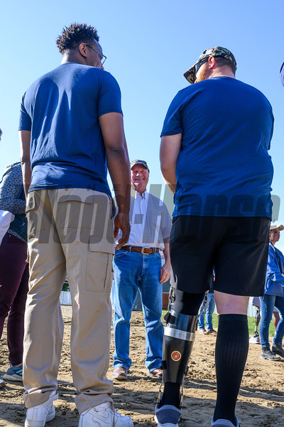 Trainer Dick Mandella, center speaks with some wounded service members at Santa Anita Race Course Wednesday October 30, 2019 in Arcadia, CA.  Photo by Skip Dickstein