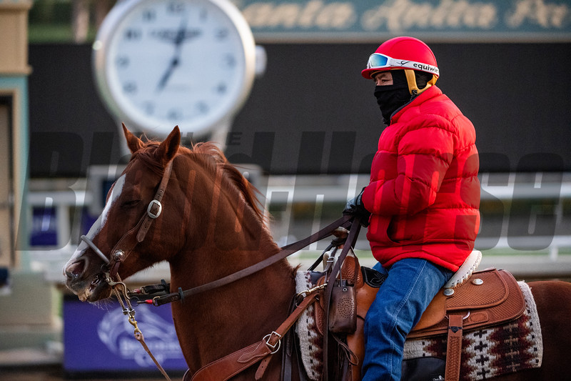 An outrider bundles up to ward off the cold at the Santa Anita Race Course Thursday October 31, 2019 in Arcadia, CA.  Photo by Skip Dickstein