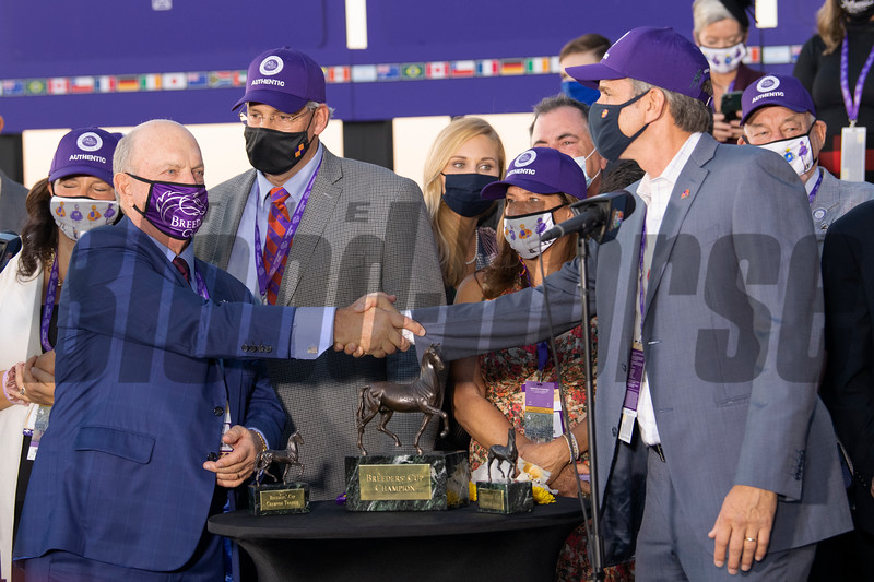(L-R) Fred Hertrich and Eric Gustavson in the winner's circle for Authentic with John Velazquez win the Breeders' Cup Longines Classic at Keeneland in Lexington, Ky. on Nov. 7, 2020.