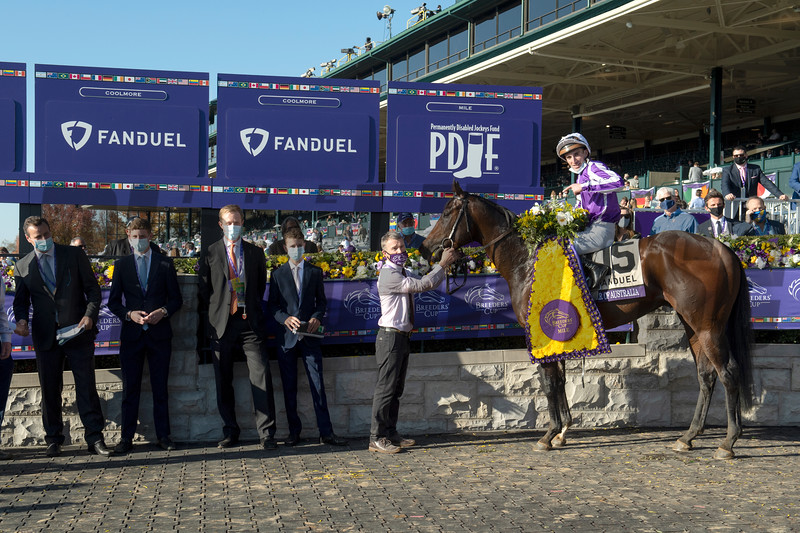 Winning connections of Order of Australia with Christophe Soumillon in the winner's circle for the Breeders' Cup Mile at Keeneland in Lexington, Ky. on Nov. 7, 2020.
