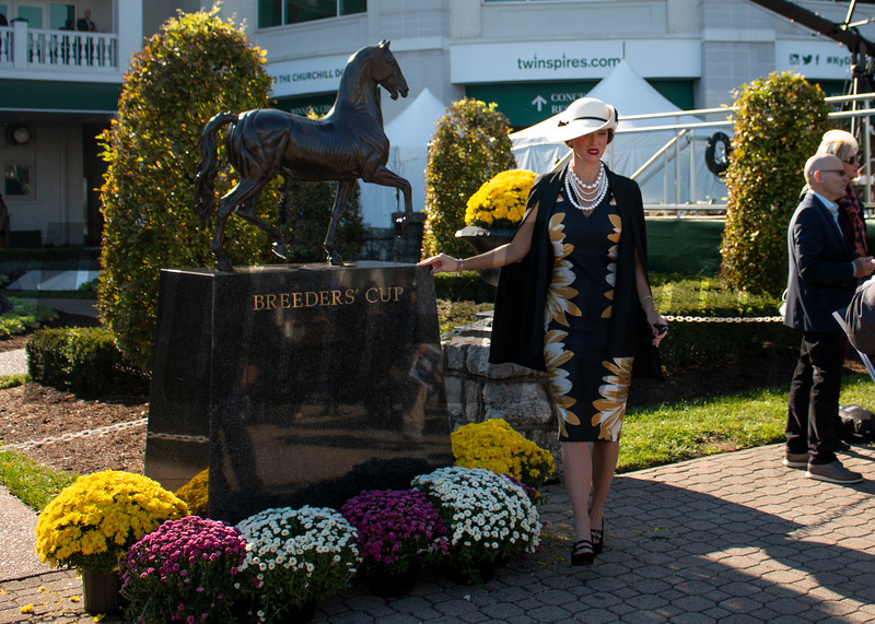 A fan poses with the Breeders' Cup trophy during the 35th Breeders' Cup on Saturday, Nov. 3, 2018, at Churchill Downs, in Louisville, Kentucky.