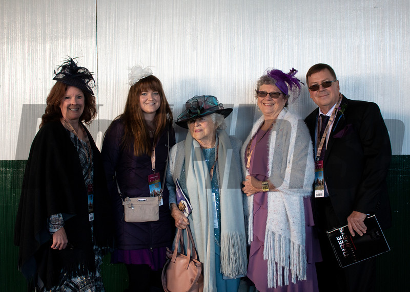 Fans pose for a photo during the 35th Breeders' Cup on Saturday, Nov. 3, 2018, at Churchill Downs, in Louisville, Kentucky.