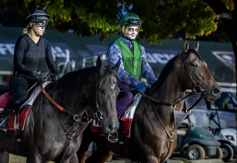 Exercise Riders Tara Lee dressed as Catwoman, left and Brody Wilkes dressed as the Joker enjoy Holloween at Churchill Downs during morning exercise Wednesday Oct. 31, 2018 in Louisville, KY.  Photo by Skip Dickstein