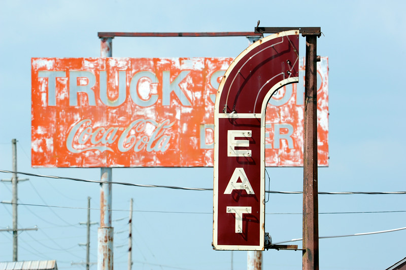 Eat old roadside sign