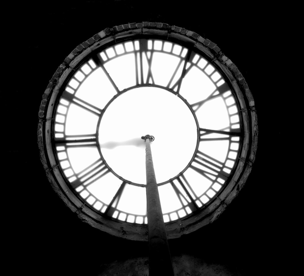 """This was a tough shot to get.  My goal was to get the gears in the center of the clock face and the bricks in sharp focus.  The face itself is """"soft"""".  <br /> It was a challenging environment to shoot in, but I am happy with the results.<br /> <br /> Woodrow Wilson Clock Tower<br /> Afternoon of January 31, 2007.<br /> Images shot in B&W<br /> Nikon D200<br /> Tamron 11-18<br /> Natural light"""