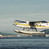 Float Plane over Coal Harbour Vancouver Bay