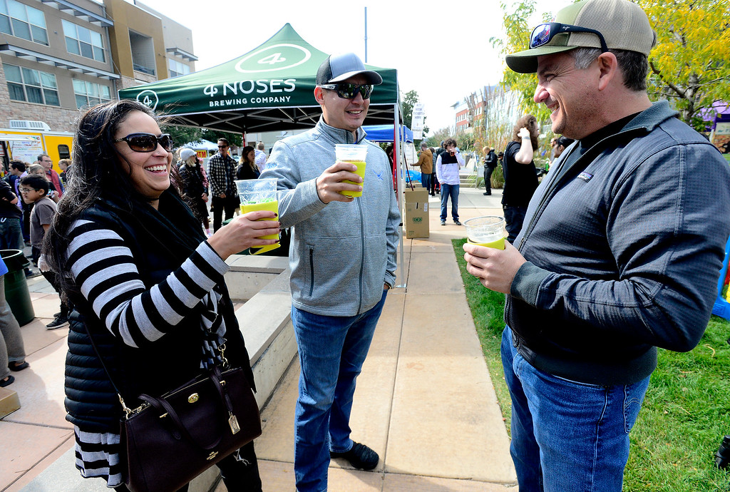 . BROOMFIELD, CO OCTOBER 6 2018 Kate and Alex Abeyta enjoy a beer and a talk with friend Scott Cadagan at BrewHaHa in Broomfield on Saturday.  (Photo by Paul Aiken/Staff Photographer)