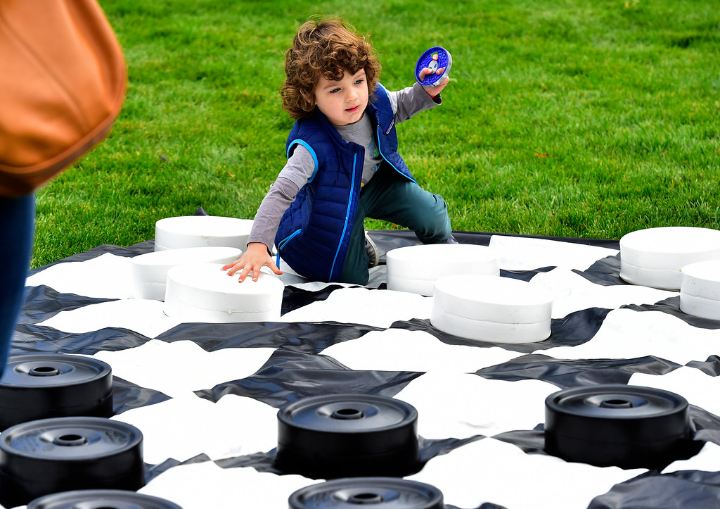 . BROOMFIELD, CO OCTOBER 6 2018 Connor Faughnan, Jr, plays his mother in a game of giant checkers at BrewHaHa in Broomfield on Saturday.  (Photo by Paul Aiken/Staff Photographer)