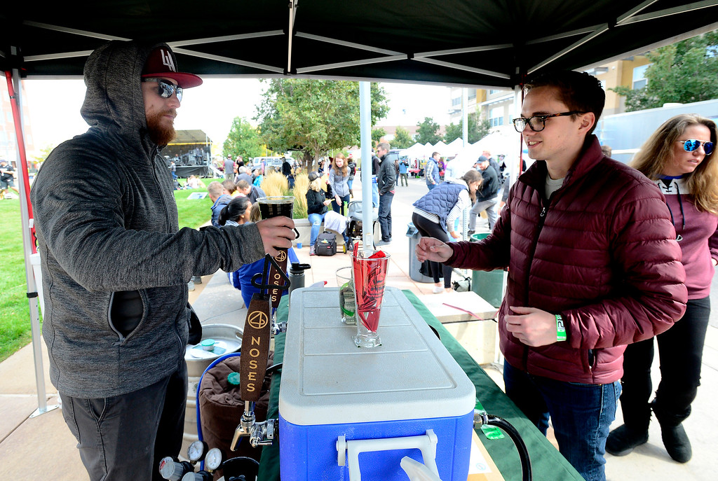 . BROOMFIELD, CO OCTOBER 6 2018 Brennan McGlynn, right, gets a beer from Dustin Ramey of 4 Noses Brewing at BrewHaHa in Broomfield on Saturday.  (Photo by Paul Aiken/Staff Photographer)