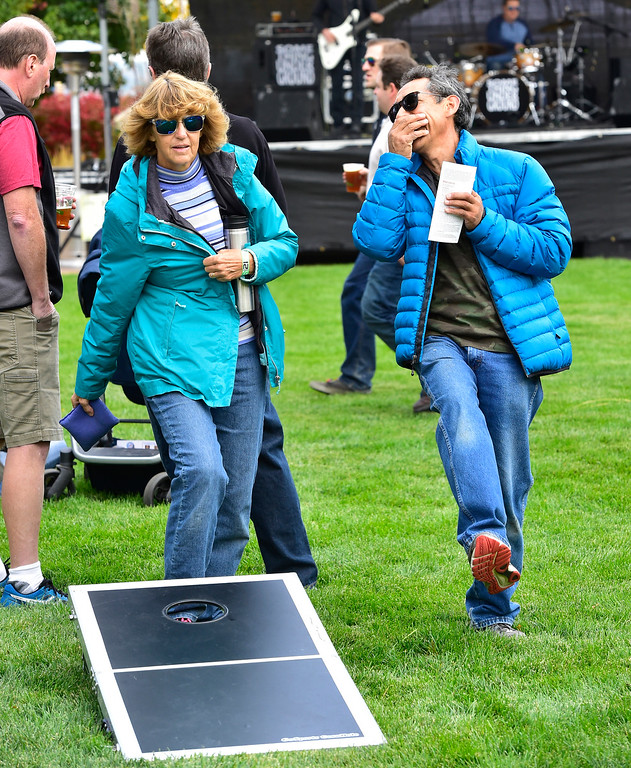 . BROOMFIELD, CO OCTOBER 6 2018 Dave and Kammy Arenas play a game of cornhole at BrewHaHa in Broomfield on Saturday.  (Photo by Paul Aiken/Staff Photographer)