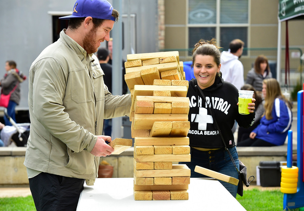 . BROOMFIELD, CO OCTOBER 6 2018 Alix Lehncrz protects the beers as Evan Thomas pulls one too many from a stacking game at BrewHaHa in Broomfield on Saturday.  (Photo by Paul Aiken/Staff Photographer)