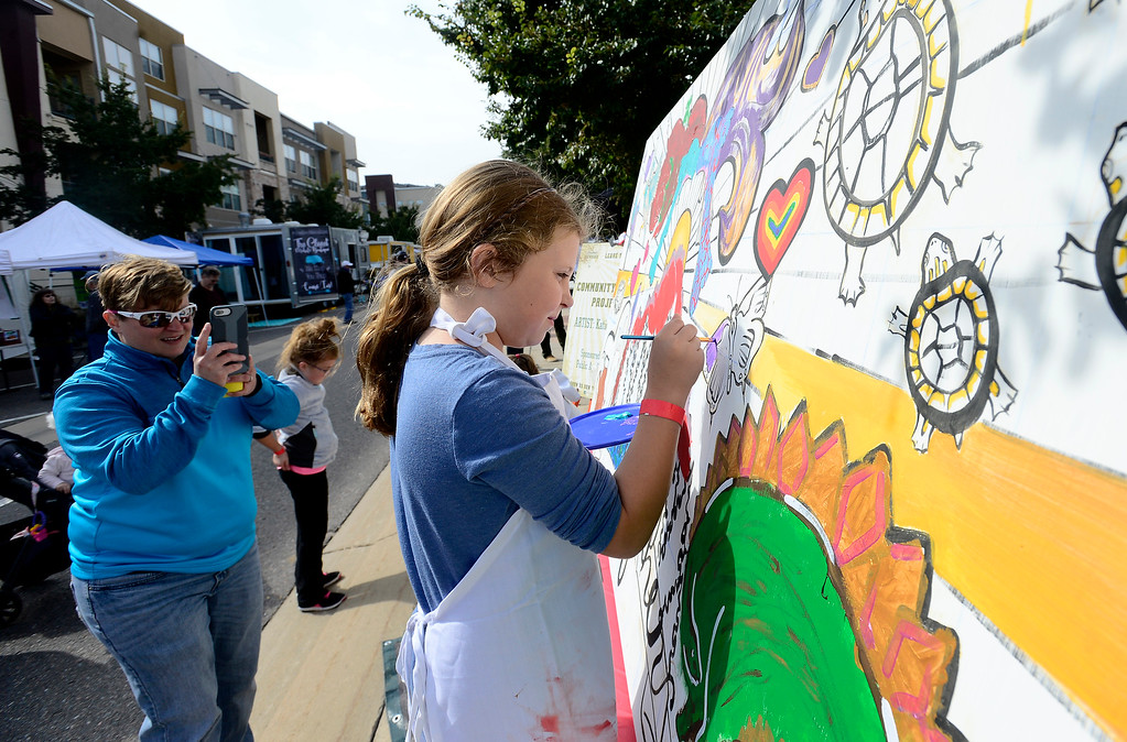 . BROOMFIELD, CO OCTOBER 6 2018 Chyler Woman, 9, paints a mural as her mom Linzy takes her photo at BrewHaHa in Broomfield on Saturday.  (Photo by Paul Aiken/Staff Photographer)