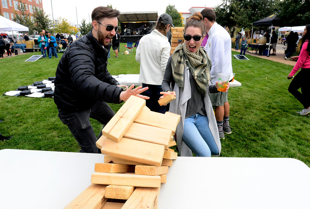 . BROOMFIELD, CO OCTOBER 6 2018 Brandon Gill and his girlfriend Kristen Temnyk watch as their stacking tower game falls at BrewHaHa in Broomfield on Saturday.  (Photo by Paul Aiken/Staff Photographer)