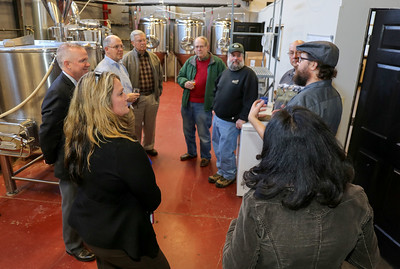 Chris Sayer, right, leads members of the New Hartford Business Council on a tour of Brewery Legitimus.  Photo by John FItts
