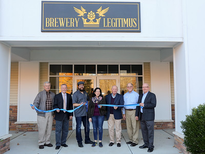 Cutting the ribbon to formally welcome Brewery Legitimus. From left are New Hartford Business Council vice president Peter Bakker, New Hartford First Selectman Daniel V. Jerram, business owners Chris and Christina Sayer, Business Council president Paul Amenta, Canton Chamber of Commerce President and business council liason Gary Miller and John Burdick, member of the business council and New Hartford EDC.  Photo by John Fitts