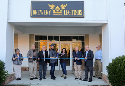 Cutting the ribbon to formally welcome Brewery Legitimus. From left are Peggy Baker,  New Hartford Business Council vice president Peter Bakker, New Hartford First Selectman Daniel V. Jerram, business owners Chris and Christina Sayer, Business Council president Paul Amenta, John Burdick and Canton Chamber of Commerce President and business council liason Gary Miller.  Photo by John Fitts