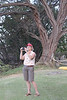 Candace and her camera framed by a large keawe tree.