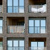 Banyan Wharf is a development for Regal Homes of 50 one, two and three bedroom apartments at 17-21 Wenlock Road in Hackney. Designed by Hawkins Brown Architects, the building is a solid cross-laminated timber structure and is manufactured off-site. The innovative CLT hybrid structural strategy was developed by timber and steel specialist B+K Structures, proved the most efficient and sustainable way to achieve the 10-storey building. The cross laminated elevations are clad in slatted western red cedar, with a dark brick screen completing the street elevation. The brick cladding was provided by Aquarian cladding and comprises Gebrik UK Stretcher SR70-90 Carbon. Client: Regal Homes. Architect: Hawkins Brown Architects LLP. Main Contractor: Regal Homes. Structural Engineer: Pringuer James Consulting Engineers. Services Engineer: Spencer Mayes. Planning Consultant: Signet Planning. CLT / Steel Contractor: B+K Structures. CLT Engineer: Engenuiti. Cladding: Cladding Design / Aquarian Cladding