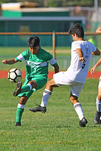 Fernando Romero (left) from Brick gets his foot on the ball as Brick Township High School takes on Monmouth Regional High School in a boys varsity soccer game in Brick on Tuesday August 3, 2019.  (MARK R. SULLIVAN THE OCEAN STAR)